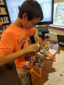 Leah McDonald - Oneida Daily Dispatch Roland Kohler, 11, sets up a Lego robot at the Oneida Public Library on Friday, Aug. 24, 2018.