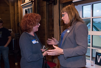 shumskis07-After_the_talk_Candidate_Hallquist_spoke_one_on_one_with_several_attendees_such_as_Anne_Quasman