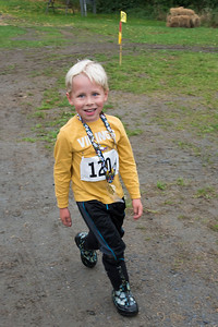 Jace Preston, 5, is the first to cross the one mile race finish line. Nancy Nutile-McMenemy photograph.