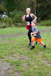 Leah and Griffin Lee cross the one mile race finish line together. Nancy Nutile-McMenemy photograph.
