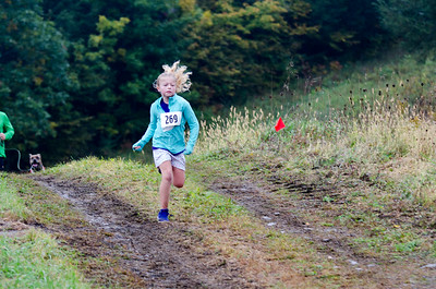 Natalie Raney races toward the finish at the 8th Annual Lucy Mac 5K9 race on Sunday, Oct. 7. Nancy Nutile-McMenemy photograph.