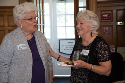 Judy Bastille shares a story with WCP Board of Directors President Megan Culp. Nancy Nutile-McMenemy photograph.