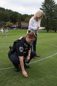 shumskis03-Woodstock_officer_Jessica_Ryan-LeBlanc_checks_for_the_number_on_the_first_ball_while_Dail_Frates_takes_notes