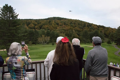 shumskis01-Part_of_the_crowd_watching_the_helicopter_circle_the_course_before_releasing_the_golf_balls