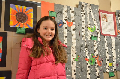 Leah McDonald - Oneida Daily Dispatch Sloane Clinch, 8, poses in front of her artwork at the Oneida City School District's district-wide art show at Otto Shortell Middle School on Tuesday, March 20, 2018. The show runs until April.