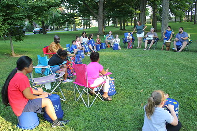 """Charles Pritchard - Oneida Daily Dispatch Children and parents at Allen Park play drums and sing as part of the Oneida Public Library's """"Rock the Library"""" summer event on Thursday, Aug. 9, 2018."""