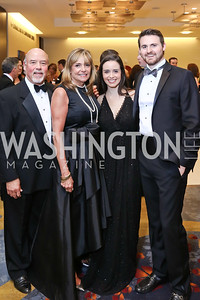 Ralph and Carey Gangitano, Alex Gangitano, Bryan Petrich. Photo by Tony Powell. 2018 Catholic Charities Gala. Marriott Marquis. April 7, 2018