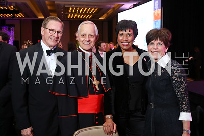 Scott Pastrick, Cardinal Donald Wuerl, Mayor Muriel Bowser, Courtney Pastrick. Photo by Tony Powell. 2018 Catholic Charities Gala. Marriott Marquis. April 7, 2018