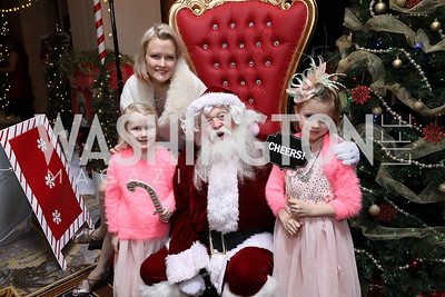 "Eleanor Rooney, Dana Rooney, Santa Claus, Vivienne Rooney. Photo by Tony Powell. 2018 CNMC ""Light Up the Season."" Four Seasons. December 16, 2018"