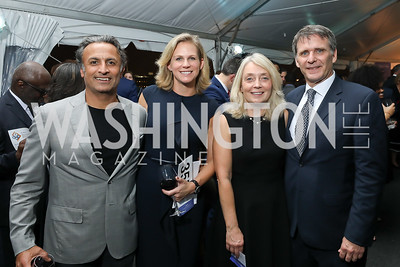 "Co-Chairs Raj and Emily Madan, Melissa McGuire and Andy Miller. Photo by Tony Powell. ""Night of Hope."" 101 Constitution. October 11, 2018"