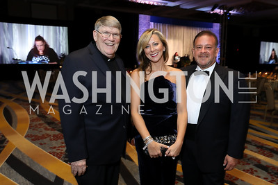 Monsignor John Enzler, Gala Chairs Jean-Marie and Raul Fernandez. Photo by Tony Powell. 2018 Spanish Catholic Center Gala. Marriott Marquis. October 27, 2018