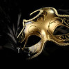A beautiful carnival mask with black feather and gold decor