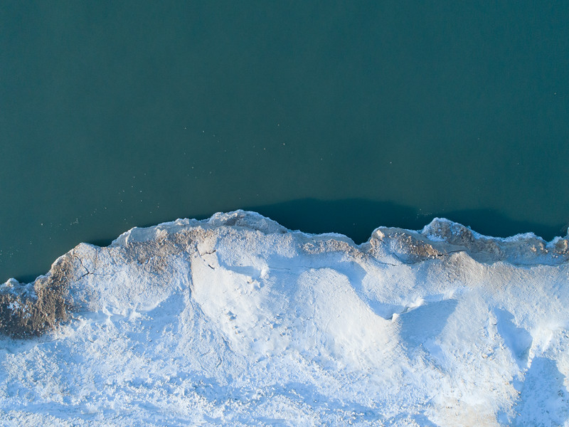 The ice forms near the Michigan City Lighthouse on Lake Michigan