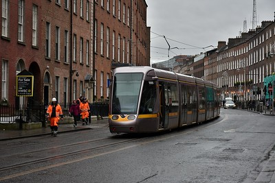 After walking along Cuffe Street on Sunday lunchtime I looked up Harcourt Street and saw a tram stopped dead with a men in orange vests around it. Turns out the OCS was damaged (possibly by 5005 but not sure) and a support cable had snapped. Sun 18.02.18