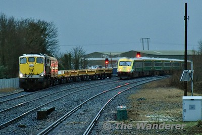 086 is pictured in Portlaoise Loop shortly after arriving with a departmental train transfer from Limerick Wagon Works, consisting of the Weedspray coach + LWR flat and 5 spoil wagons. 4006 has just passed the station on the rear of the 1600 Heuston - Cork. Tues 16.01.18