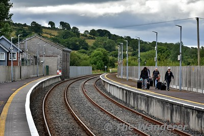 A group of American tourists, who nearly got overcarried at Farranfore walk down the platform. They then attempted to walk down the platform ramp instead of the footbridge and weren't that impressed when we told them they must use the footbridge. Your not in the USA now! Sun 15.07.18