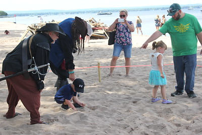 Charles Pritchard - Oneida Daily Dispatch Children search in the sand for gold dubloons for Pirates Weekend on Saturday, July 21, 2018.