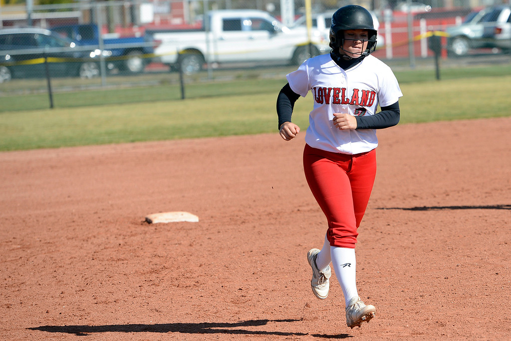 . Loveland\'s Elana Gerhard rounds the bases after a hitting a home run during a regional against Smoky Hill on Oct. 14, 2017 at Brighton High School. (Sean Star/Loveland Reporter-Herald)