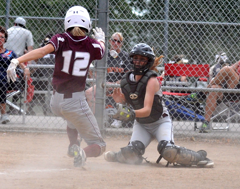 . Berthoud catcher Madi Laib corrals the ball as Golden\'s  Cassidy Paulson slides into home during the Berthoud Spartan Classic on Saturday Sept. 9, 2017 at the Barnes Complex. (Cris Tiller / Loveland Reporter-Herald)
