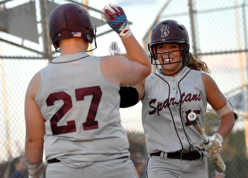 . Berthoud\'s Addison Spears (15) high fives Ashlynn Balliet (27) after scoring against Thompson Valley on Friday Aug. 25, 2017 at Centennial Park. The Spartans won 17-6. (Cris Tiller / Loveland Reporter-Herald)