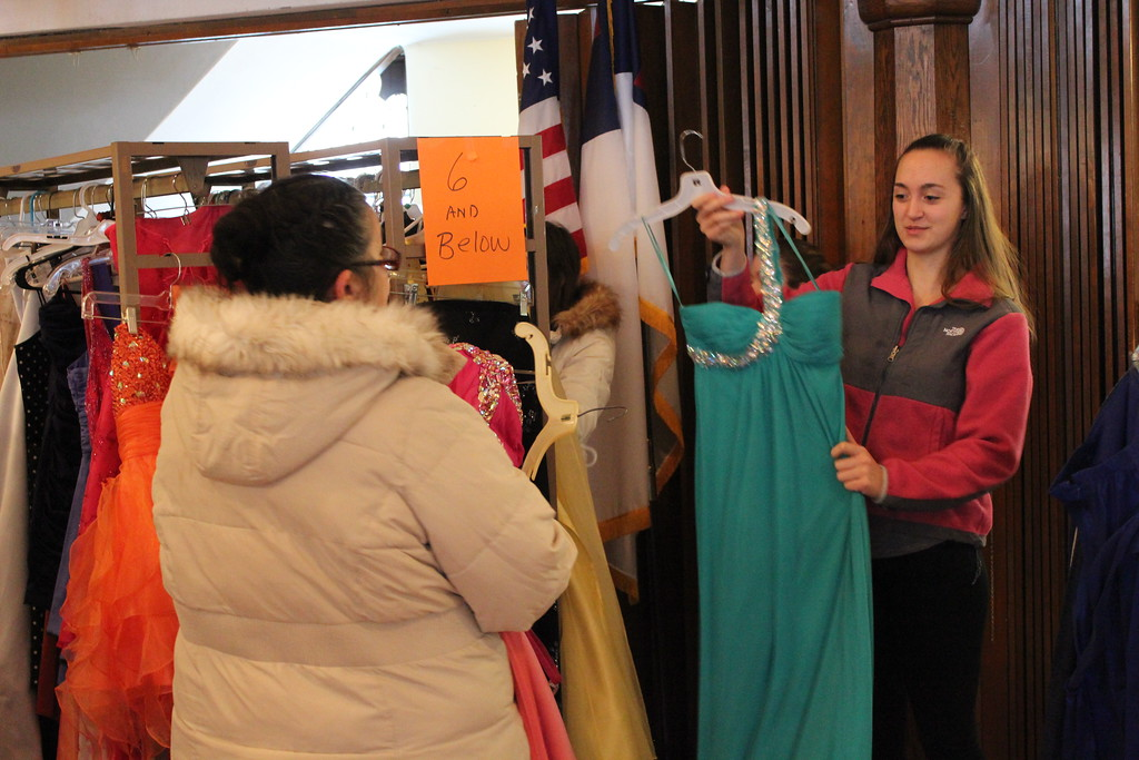 . Charles Pritchard - Oneida Daily Dispatch Isabella Scholl, right, and her mother Mary Ann Scholl look through dresses at the First Presbyterian Church\'s Prom Dress Giveaway in Oneida on Saturday, Feb. 10, 2018.