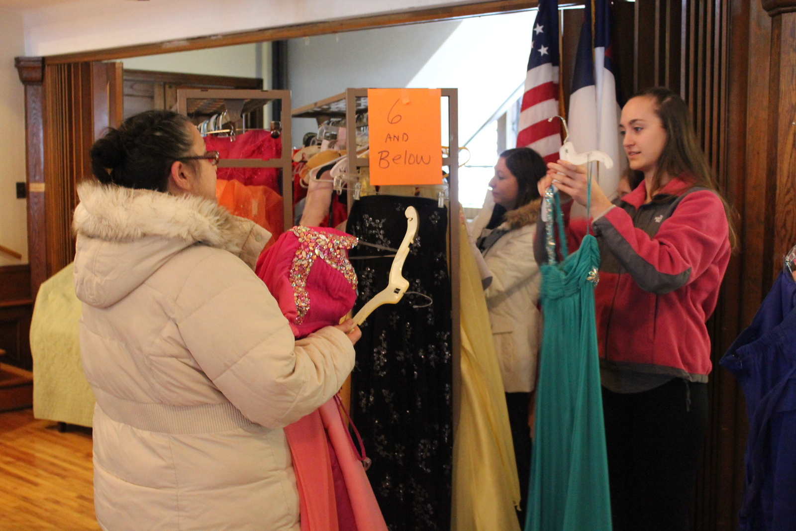 Charles Pritchard - Oneida Daily Dispatch Isabella Scholl, right, and her mother Mary Ann Scholl look through dresses at the First Presbyterian Church's Prom Dress Giveaway in Oneida on Saturday, Feb. 10, 2018.