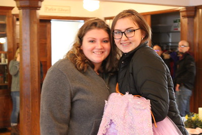 Charles Pritchard - Oneida Daily Dispatch Autumn Naylor, left, and her cousin Samantha Mongeon smle after finding the perfect dress for Autumn's Junior Prom at the First Presbyterian Church's Prom Dress Giveaway in Oneida on Saturday, Feb. 10, 2018.