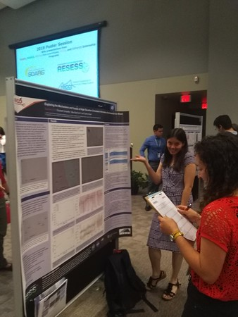 Elizabeth Schaeffer, intern, presenting her poster like a boss at UCAR Center Green campus. August 3, 2018 (Photo: Jordan Wachholtz).