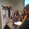 Beth Schaffer (left), a 2018 RESESS intern, telling fern jokes during her poster presentation at UCAR Center Green campus. August 3, 2018 (Photo: Jordan Wachholtz).