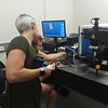RESESS intern Haley (in green) discussing research with graduate student mentor Colin Sturrock in a lab at the Benson Earth Sciences building. July 10, 2018 (Photo: Jordan Wachholtz).