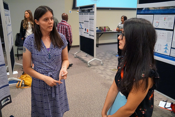 2018 RESESS intern Beth discusses her summer work with the public at the end of summer poster session.  August 2, 2018.  Boulder, Colorado.  (Photo/Daniel Zietlow, UNAVCO)