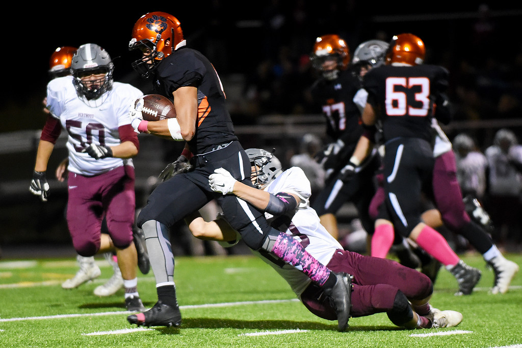 . Berthoud\'s Brock Johnson (on the tackle).  Kira Vos / Special to the Camera / October 7, 2016