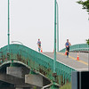Sarah Mulcahey and Robert Ashby crossing the bridge to Canada during the sixth Bay of Fundy International Marathon, June 24, 2018. About two hours later, they crossed the finish line as winners. Photo credit: Lisa M. Dellwo