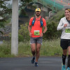 Nicholas Brown (20) of Ellsworth, ME, and Kelly Duffy (10) of Chicago, IL, cross into Canada during the Bay of Fundy International Ultra-marathon, June 24, 2018. Photo credit: Lisa M. Dellwo