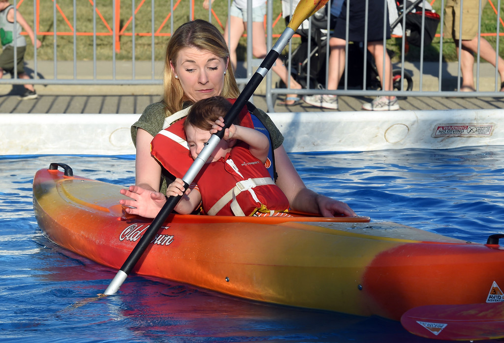 . Cora Noffsinger, 2, rows the kayak,  as her aunt, Abby Noffsinger, tries to avoid being hit with the paddle, helps  with the kayak during the annual Rhythm on the River in Longmont on Saturday. For more photos,  go to dailycamera.com.  Cliff Grassmick / Staff Photographer/ July 14, 2018