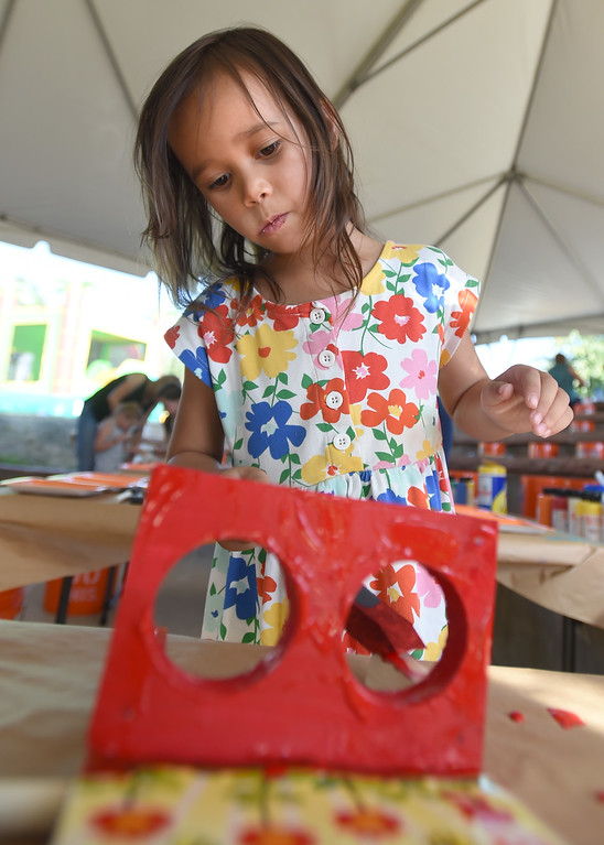 . Sophia Mettler, 5, paints a craft at the Home Depot tent during the annual Rhythm on the River in Longmont on Saturday. For more photos,  go to dailycamera.com.  Cliff Grassmick / Staff Photographer/ July 14, 2018