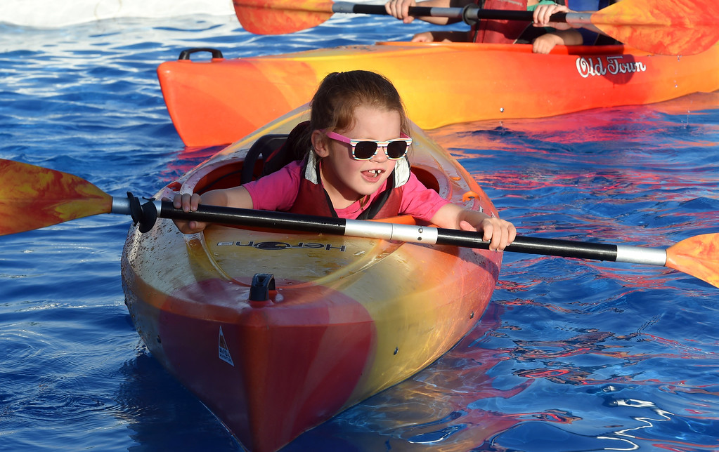 . Ella Noffsinger, 5, gets her kayak moving during the annual Rhythm on the River in Longmont on Saturday. For more photos,  go to dailycamera.com.  Cliff Grassmick / Staff Photographer/ July 14, 2018