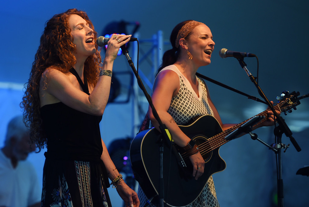 ". Julia Adams, left, and Amy Francis, of ""She Rises,\"" sings during the annual Rhythm on the River in Longmont on Saturday. For more photos,  go to dailycamera.com.  Cliff Grassmick / Staff Photographer/ July 14, 2018"