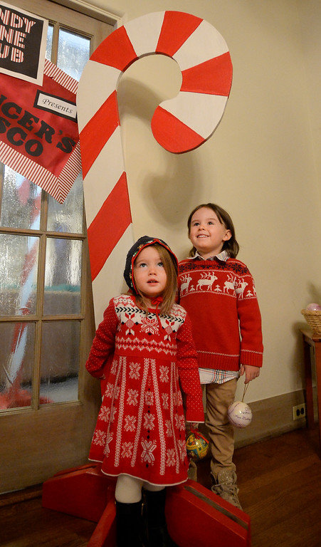 . BOULDER, CO - November 29, 2018:  Fiona Riddell, left, and her brother, Tucker, pose by a candy cane.  Santa\'s House, the annual benefit for families and children of Boulder, is open to the public Saturday and Sunday, December 1 & 2 from 10 AM to 4 PM.  Santa\'s House, which is sponsored by the Boulder Area Alumnae Panhellenic, is  at 890 11th Street, Boulder, the Pi Beta Phi sorority house.  Admission is $5 per person and each child receives a personalized keepsake ornament.  (Photo by Cliff Grassmick/Staff Photographer)