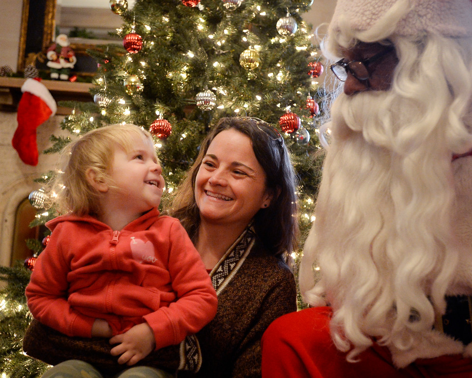. BOULDER, CO - November 29, 2018: Jane Williams, and her mother, Katherine, were able to meet Santa, Rich Lopez. Santa\'s House, the annual benefit for families and children of Boulder, is open to the public Saturday and Sunday, December 1 & 2 from 10 AM to 4 PM.  Santa\'s House, which is sponsored by the Boulder Area Alumnae Panhellenic, is  at 890 11th Street, Boulder, the Pi Beta Phi sorority house.  Admission is $5 per person and each child receives a personalized keepsake ornament.  (Photo by Cliff Grassmick/Staff Photographer)