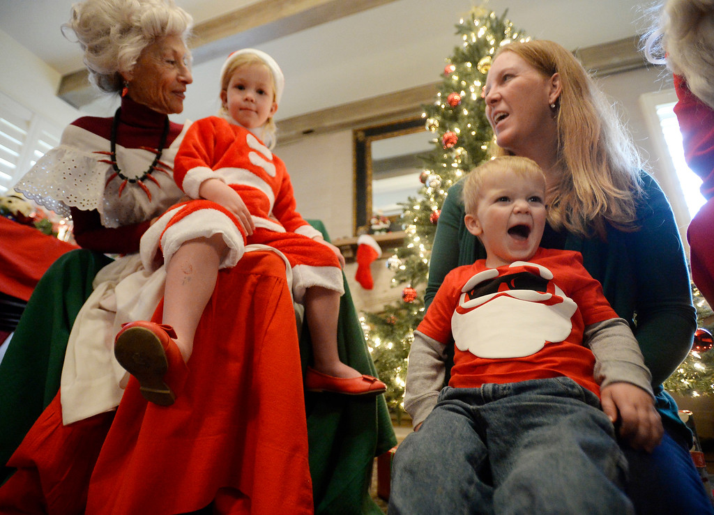 . BOULDER, CO - November 29, 2018:  Jillian Hayes, and her brother, Callan, and their mother, Lynn, were able to meet Mrs. Santa, Jeannie DeMarinis. Santa\'s House, the annual benefit for families and children of Boulder, is open to the public Saturday and Sunday, December 1 & 2 from 10 AM to 4 PM.  Santa\'s House, which is sponsored by the Boulder Area Alumnae Panhellenic, is  at 890 11th Street, Boulder, the Pi Beta Phi sorority house.  Admission is $5 per person and each child receives a personalized keepsake ornament.  (Photo by Cliff Grassmick/Staff Photographer)