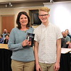 "Brette Confair is presented with ""Nightbooks"" by Jackson Fink from Williamsport Area Middle School."