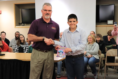 """Marc Schefsky is presented with """"S.M.A.R.T.S."""" by Corban Shirey from Lycoming Valley Intermediate School."""