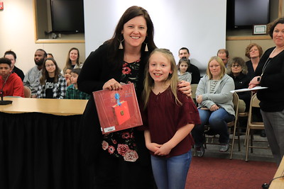 """Jennifer Lake is presented with """"A Child of Books"""" by Kinsley Cannode of Hepburn-Lycoming Primary School."""