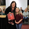 "Jennifer Lake is presented with ""A Child of Books"" by Kinsley Cannode of Hepburn-Lycoming Primary School."