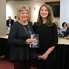 "President Lori Baer is presented with ""Proud"" by Rowan Tupper of Williamsport Area Middle School."