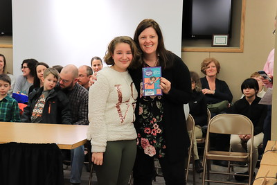 """Jennifer Lake is presented with """"Squishy Taylor and a Question of Trust"""" by Zoe Brosan from Lycoming Valley Intermediate School."""