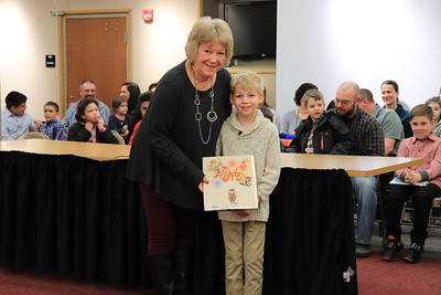 """President Lori Baer is presented with """"The Wonder"""" by Adam Pritchard from Jackson Primary School."""
