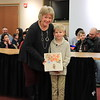 "President Lori Baer is presented with ""The Wonder"" by Adam Pritchard from Jackson Primary School."