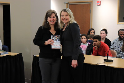 """Vice President Dr. Jane Penman is presented with """"Gigged: The End of the Job and the Future of Work"""" by Alexis Griess from Williamsport Area High School."""